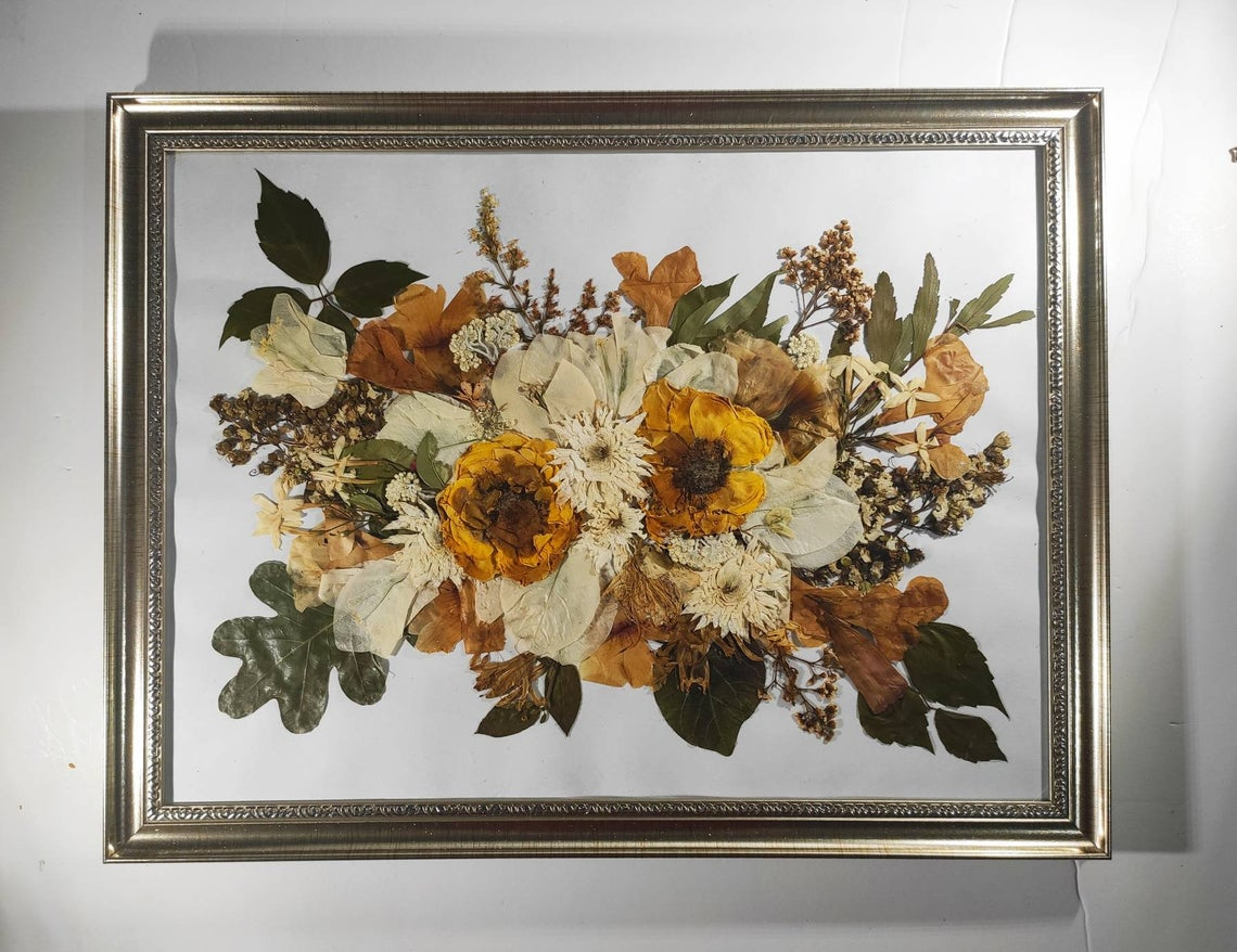 Large pressed flower bouquet in a silver frame