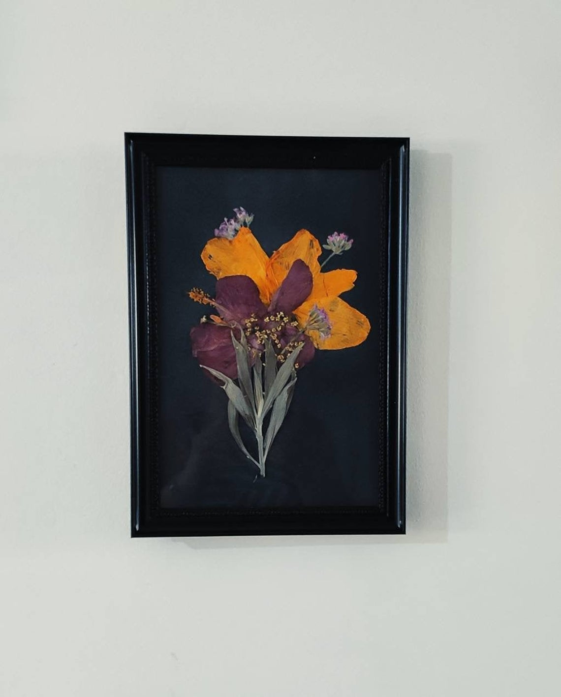 Orange and purple pressed lilies framed wall art